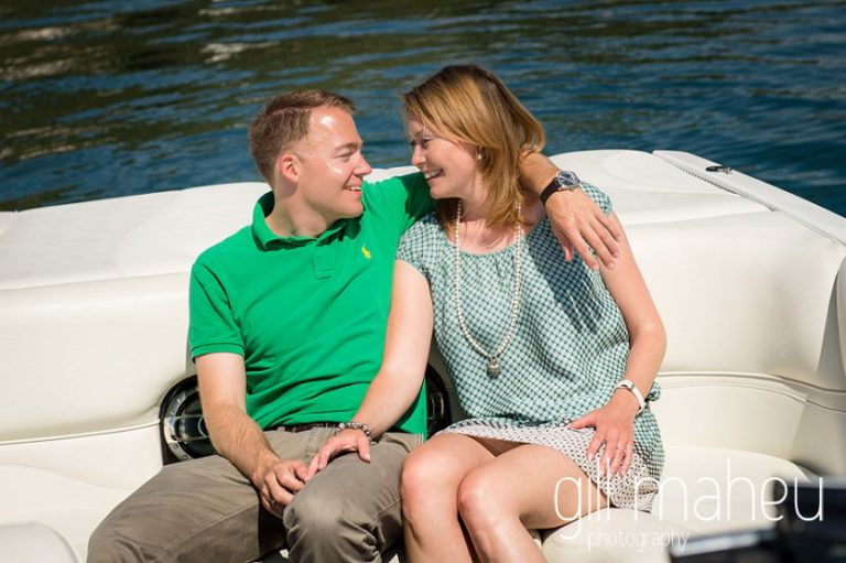 engaged couple chatting on speed boat on Lac Léman, Lausanne engagement session by Gill Maheu Photography, photographe de mariage