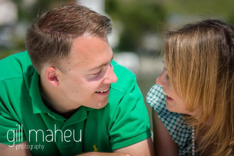 close up of bride and groom looking into each other eyes on on speed boat on Lac Léman, Lausanne engagement session by Gill Maheu Photography, photographe de mariage