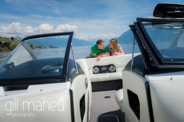 bride and groom looking into each other eyes on on speed boat on Lac Léman, Lausanne engagement session by Gill Maheu Photography, photographe de mariage