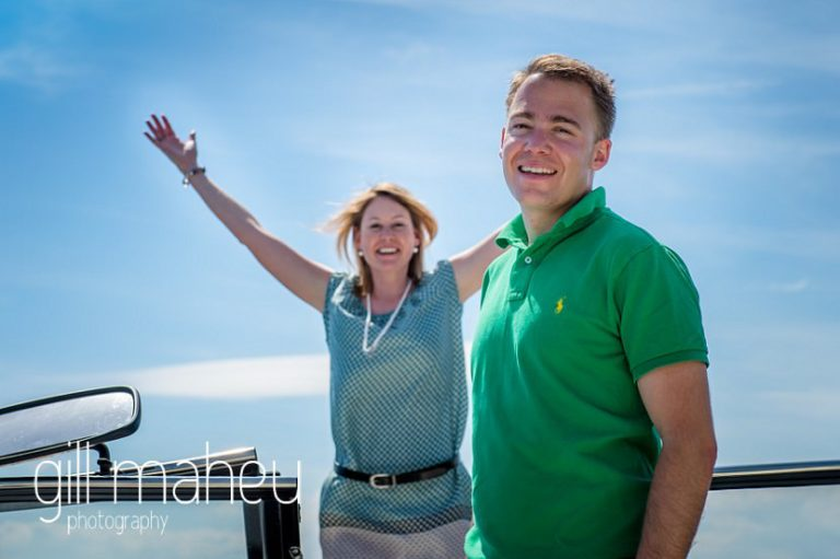 bride celebrating with groom on speed boat on Lac Léman, Lausanne engagement session by Gill Maheu Photography, photographe de mariage