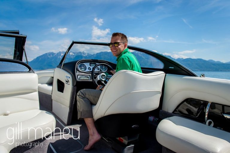 groom piloting speed boat on Lac Léman, Lausanne engagement session by Gill Maheu Photography, photographe de mariage