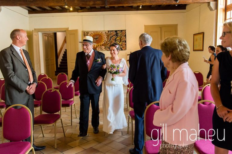 Father of the bride walking bride down the aisle at Chateau de Coppet, Geneva wedding by Gill Maheu Photography, photographe de mariage