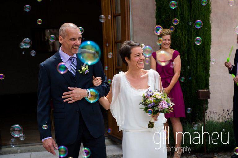 bride and groom leaving wedding celebrations under bubble confetti at Chateau de Coppet, Geneva wedding by Gill Maheu Photography, photographe de mariage