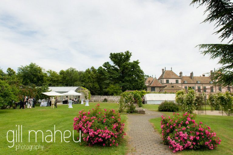 wide angle view of wedding marquee with chateau in the background at Chateau de Coppet, Geneva wedding by Gill Maheu Photography, photographe de mariage