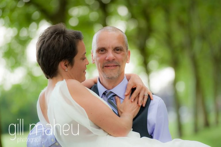 bride in groom's arms at Chateau de Coppet, Geneva wedding by Gill Maheu Photography, photographe de mariage
