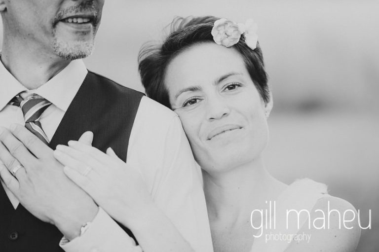 black and white of beautiful bride with her head resting on groom's shoulder staring at the camera Chateau de Coppet, Geneva wedding by Gill Maheu Photography, photographe de mariage