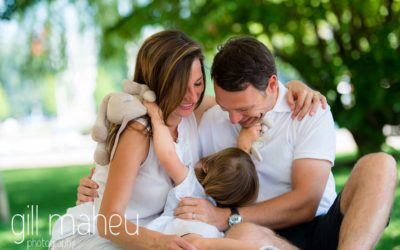 portrait of mum dad and young daughter cuddling on Le Paquier, Lake Annecy by Lifestyle photographer Gill Maheu Photography, photographe de famille