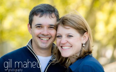 portrait of couple smiling at the camera in the gardens of Le Paquier on lifestyle photo session in the Vielle Ville of Annecy by Gill Maheu Photography, photographe de mariage et de famille