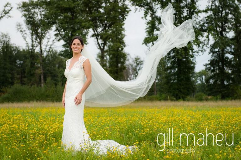 portrait of beautiful bride in Monique l'huillier lace wedding dress with cathedral veil floating down on Geneva love the dress day after session by Gill Maheu Photography, photographe de mariage