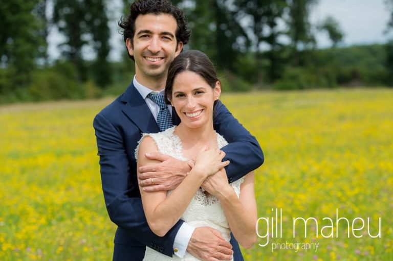 bride and groom hugging in a field of golden flowers on Geneva love the dress day after session by Gill Maheu Photography, photographe de mariage