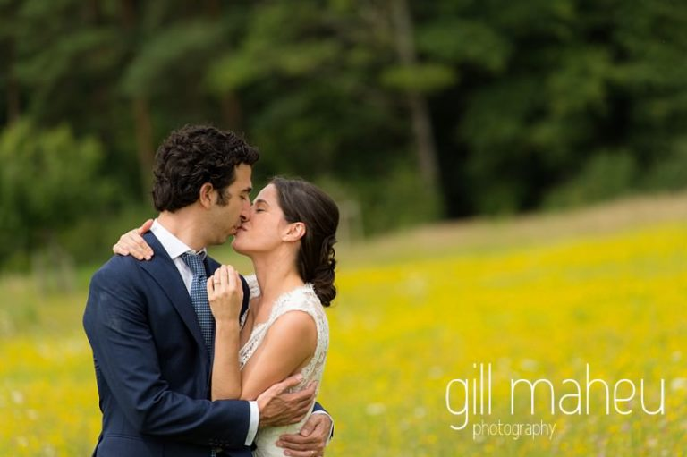 bride and groom embracing in a field of golden flowers on Geneva love the dress day after session by Gill Maheu Photography, photographe de mariage