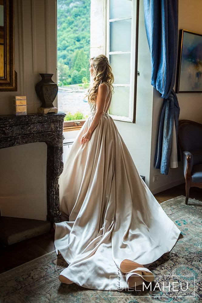 full length portrait of bride in fabulous long trainned MAdison James wedding dress in bridal suite at Abbaye de Talloires, Annecy wedding by Gill Maheu Photography, photographe de mariage