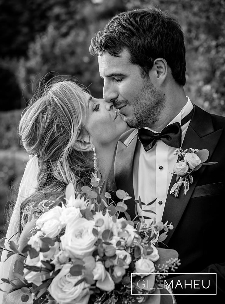 black and white portrait of bride and groom kissing at Abbaye de Talloires, Annecy wedding by Gill Maheu Photography, photographe de mariage