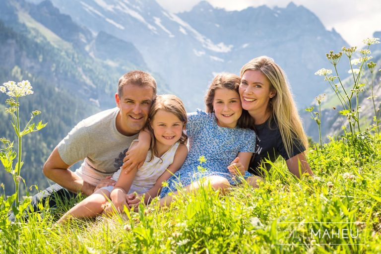 close up of mum and dad and two daughters at summer sun lifestyle photography session with beautiful young family in Gimmelwald, Switzerland by Lifestyle photographer Gill Maheu Photography, photographe de famille