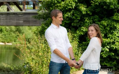 couple laughing together hand in hand at sunny family session near Geneva, Switzerland by Lifestyle photographer Gill Maheu Photography, photographe de famille