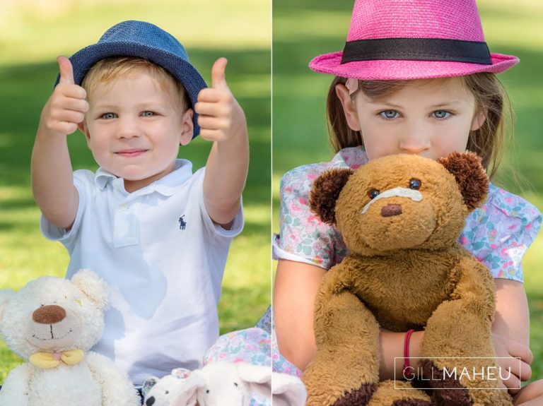 little boy giving a great big thumbs up side and little girl hugging her teddy tightly at summer sun lifestyle photography session with beautiful young family in Lausanne by Lifestyle photographer Gill Maheu Photography, photographe de famille